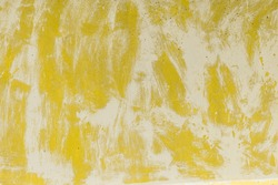Cool cement wall texture. Washed watercolor yellow paint over white paint on old concrete or cement surface. Abstract grunge background.  Color of the year 2021 - illuminating yellow.