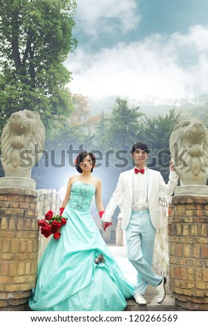 cool chinese couple,outdoors. - stock photo