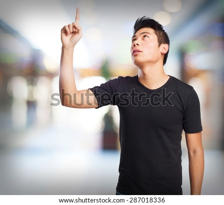 cool chinese-man pointing up