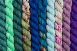 Cool colored hues of yarn twisted into hanks