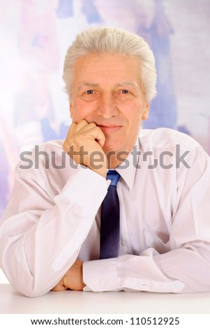 Cool elderly man in suit on light background