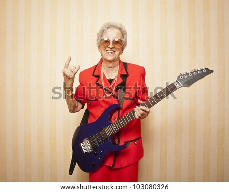 cool fashion elder lady with electric guitar - stock photo