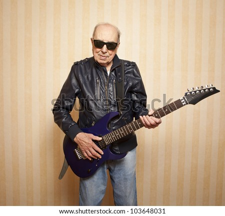 cool fashion elder man with electric guitar