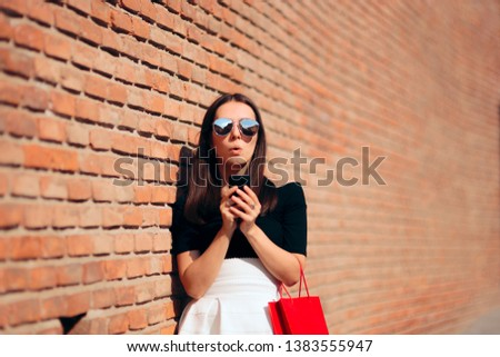 Cool Fashion Woman Checking Smartphone after Shopping Session. Female tourist using her phone to get direction in touristic city
