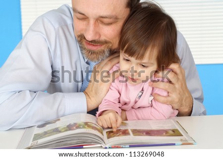 Cool father sits with his daughter at home