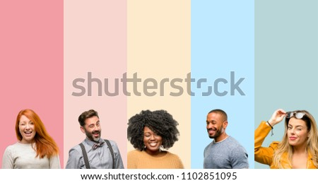Cool group of people, woman and man blinking eyes with happy gesture