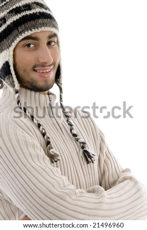 cool guy wearing winter cap and looking at camera on an isolated white background