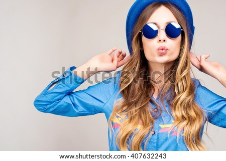 Cool hipster student woman wearing eyewear glasses . Caucasian female university student looking at camera smiling happy. #407632243