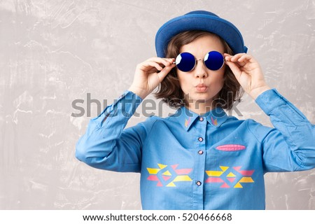 Cool hipster student woman wearing eyewear glasses . Caucasian female university student looking at camera smiling happy