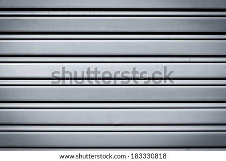 Cool industrial metal door background with dark corners