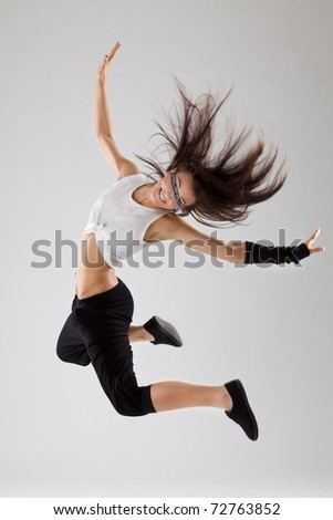 cool looking dancer posing on a grey background