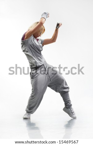 cool looking dancer posing on a white background - stock photo