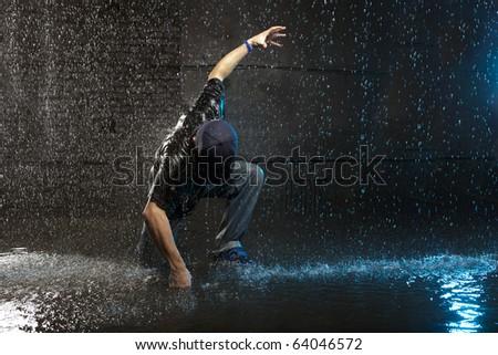 Cool looking hip-hop dancer in aqua studio