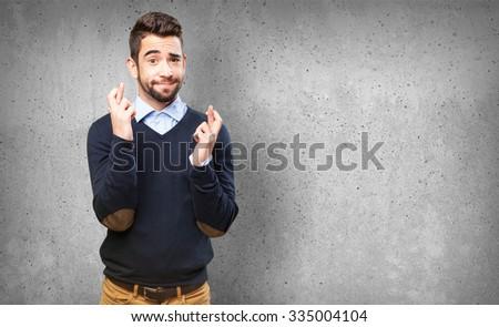cool man crossing fingers #335004104