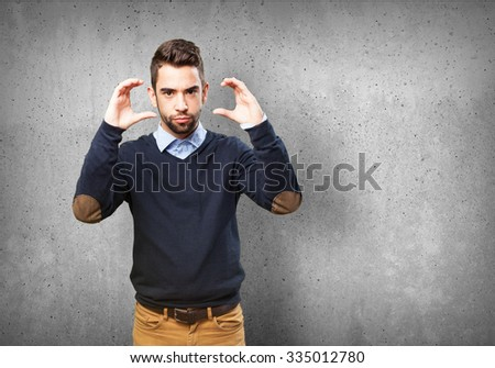 cool man holding symbol #335012780