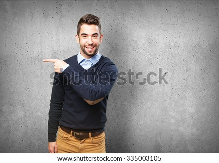 cool man pointing to copy space #335003105