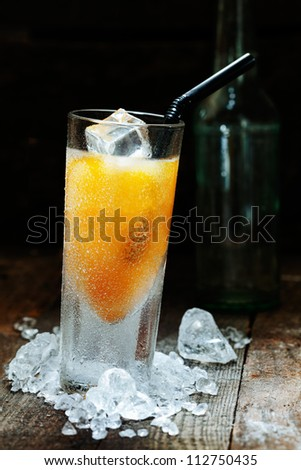 Cool Mango Alcohol Drink with crushed Ice on wooden table for drink concepts