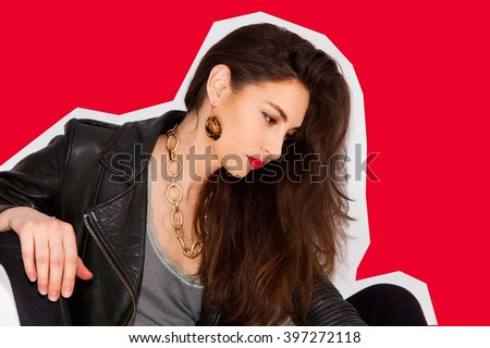 Cool millennial beautiful girl in black leather jacket with long brunette hair posing. Conceptual minimalist design photo, retouched.