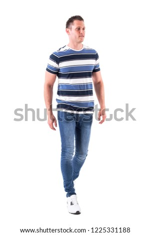 Cool relaxed casual man wearing t-shirt and jeans walking casually. Full body isolated on white background.  #1225331188