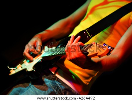 Cool rock guitar player  in a rock concert