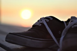 Cool Shoes in evening sunset on sea art