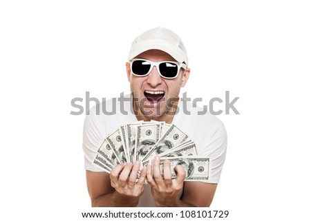 Cool smiling man in sunglasses with full hands holding dollar currency cash