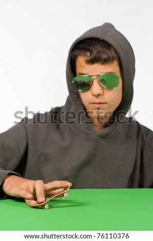 stock photo cool teen posing with a tiny toy skateboard 76110376 Talk with your teen partner, friends, parents often about sex, contraception ...