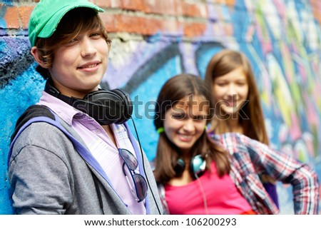 Cool teenagers hanging out together outdoors
