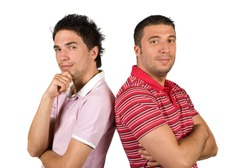 Cool two friends guys standing back to back with hands crossed and looking at you isolated on white background