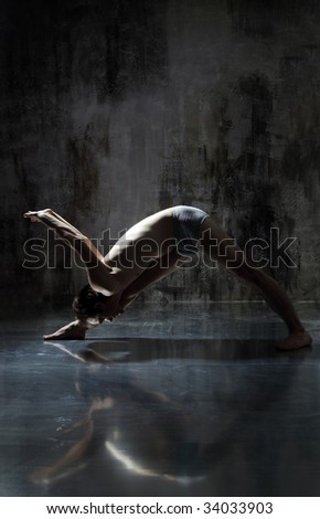 Cool yoga man posing on dirty grunge background stock photo