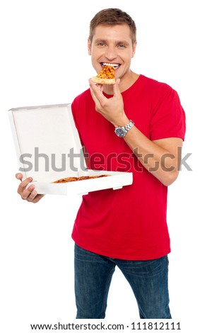 Cool young guy enjoying pizza isolated over white background