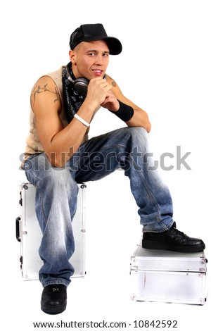 Cool Young Man With Headphones Young man sitting on dj cases with headphones and lots of tattoos.