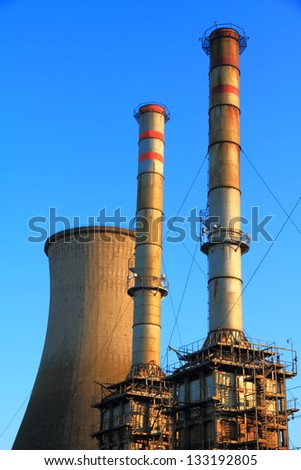 Cooling tower and metal chimneys of an electrical plant