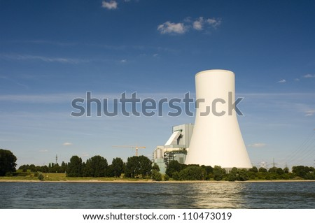 cooling tower at the riverside - stock photo