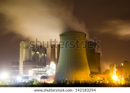 Cooling towers of a large power station - stock photo