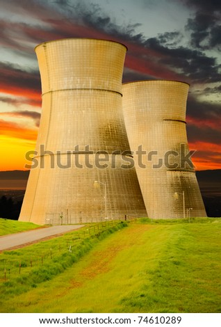 cooling towers of a nuclear power station at sunset