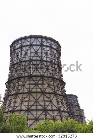 Cooling towers of heating plant - stock photo