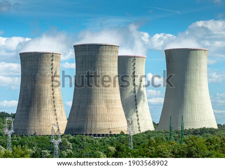 Cooling towers of nuclear power plant Mochovce with cloudy sky in the background. Nuclear power station. ストックフォト ©