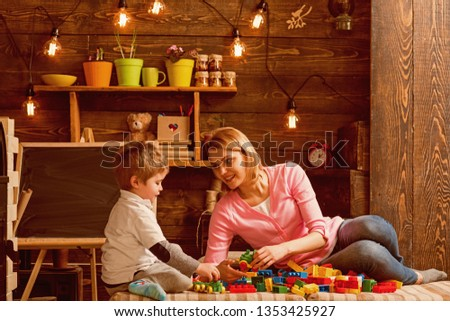 Cooperation concept. Mother and son cooperate in building structure model, cooperation. Cooperation and cooperative learning. Cooperation in education.