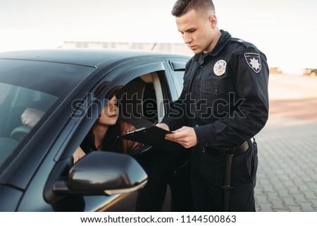 Cop in uniform checks license of female driver