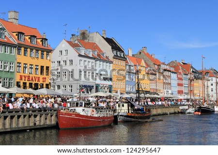 COPENHAGEN, DENMARK - JUNE 5: Crowds gather at Nyhavn, the landmark medieval port and bar district, on June 5, 2010 to celebrate the anniversary of Constitution Day in Copenhagen, Denmark.
