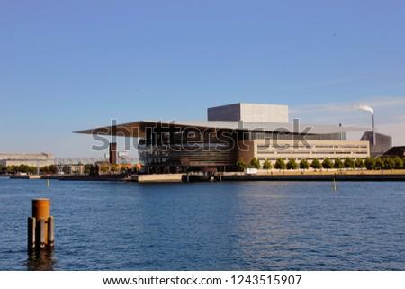 Copenhagen, Denmark - June 26, 2018: Exterior view of the Copenhagen opera house, costructued 2001-2004 in neo-futurism style, located at Holmen. #1243515907