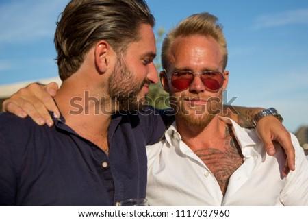 Copenhagen, Denmark - June 9 2018 : Two young good looking Danish men pose for a photograph in Christianshavn, Copenhagen #1117037960