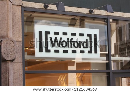 Copenhagen, Denmark - June 26, 2018: Wolford logo on store front. Wolford is founded in 1949 employs and is one of most recognized lingerie and hosiery brands today. #1121634569