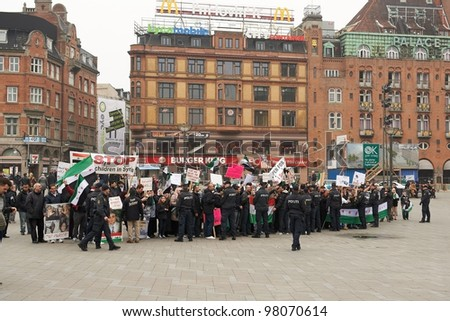COPENHAGEN, DENMARK - MARCH 18: People protesting against Bashar al-Assad politic in Syria on City Hall Square on March 18, 2012 in Copenhagen, Denmark