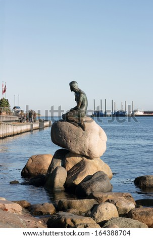 COPENHAGEN, DENMARK - OCTOBER 28 : Little Mermaid statue sitting on a rock on the harborfront in the northern Kastellet area on October 28, 2012 in Copenhagen, Denmark