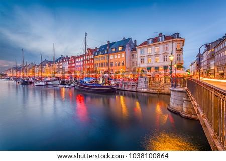 Copenhagen, Denmark skyline on the Nyhavn Canal at twilight.