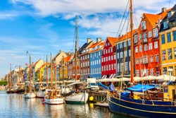 Copenhagen iconic view. Famous old Nyhavn port in the center of Copenhagen, Denmark during summer sunny day.
