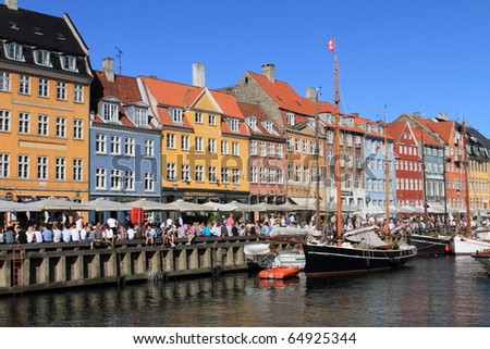 COPENHAGEN - JUNE 5: crowds gather at Nyhavn, the landmark medieval port and bar district, to celebrate the anniversary of Constitution Day on June 5, 2010 in Copenhagen, Denmark.