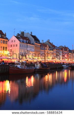 COPENHAGEN - JUNE 5: crowds gathered at Nyhavn at twilight to celebrate the anniversary of Constitution Day on June 5, 2010 in Copenhagen, Denmark.